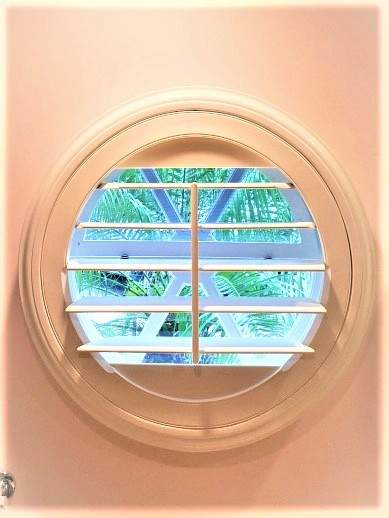 Round window with a Shutter