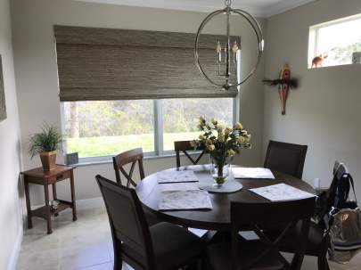 Horizon Woven Wood Roman Shade in Dining Room