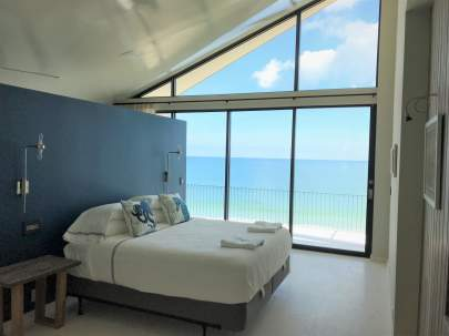 Ocean view bedroom window no curtains