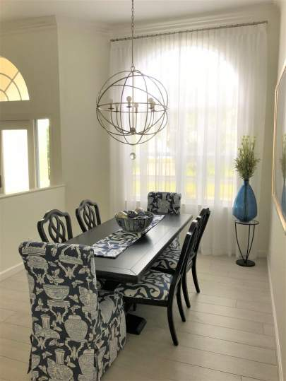 Sheer curtains and drapery rod in dining room