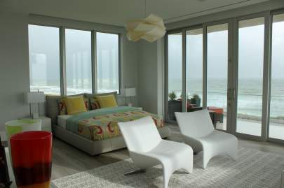 Bedroom with motorized shades in the up position