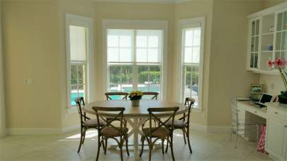 Roller shades in breakfast nook windows