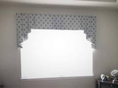 Bedroom window with day shade and valance