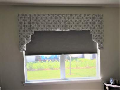 Bedroom window with black out shade and valance