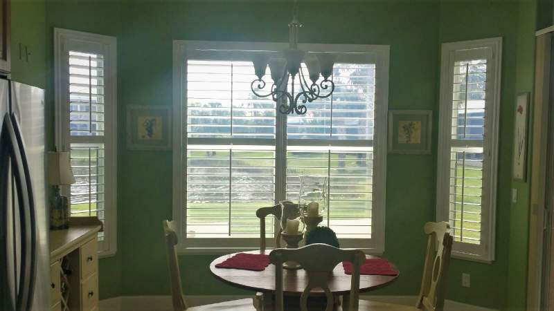 Norman window shutters in breakfast nook