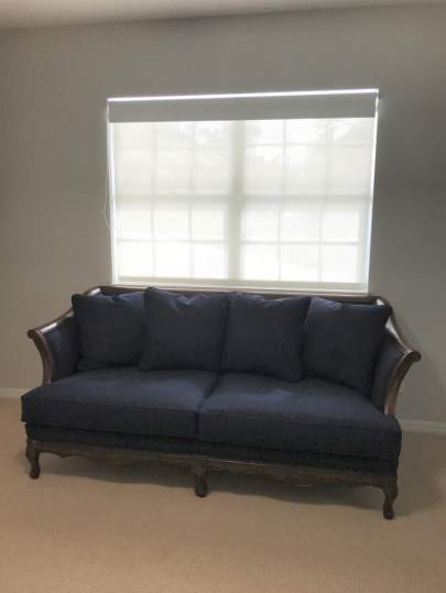 Blue couch with no pillows