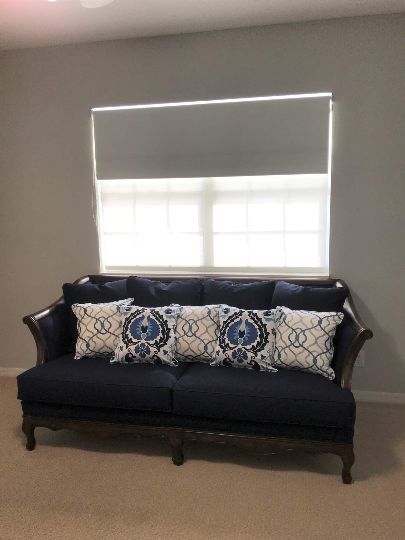 White Shade above Blue couch